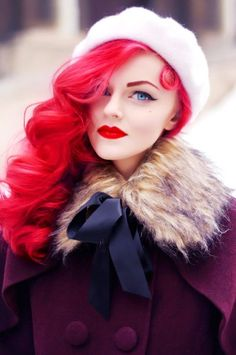I adore this shot, the way she looks so classically, retro-style beautiful, with the pop of mod in her bright hair. Awesome.