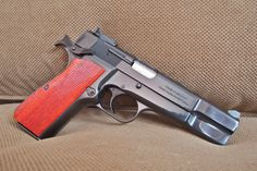 FN Browning Hi-Power with Craig Spegel grips Find our speedloader now! http://www.amazon.com/shops/raeind