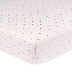 You and your little dreamer will love the pretty shimmer and shine of Just Born's Sparkle Fitted Crib Sheet. This soft cotton sheet features an allover glimmer design to add a touch of sparkly fun to your nursery.