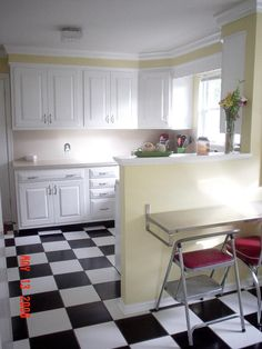 kitchen flooring black and white  this? or on the diagonal? to cover up the yellow...