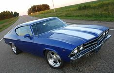 69 Malibu SS I had one of these but navy with white vinyl roof.