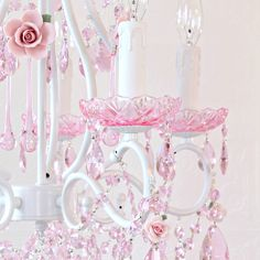 Inspired by centuries-old Fairy-tales fantasy and romance, this 5-light white chandelier has been dressed to impress with LOADS of PINK crystal prisms and fancy-cut pink glass bobeches! Spectacular pink porcelain roses in full bloom make this chandelier a true vision in pink, elegant, sparkly and undeniably dreamy.