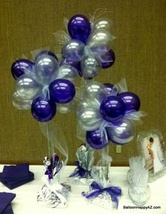 Instead of flowers, choose a balloon gift of centerpiece. Fun, classy, silly - always unique and memorable. What a great idea!