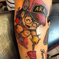 French pop singer Alizee's latest tattoo on her right forearm is of Arale-chan and Unchi-kun from the Japanese manga/anime 'Dr. Slump.' The new work depicts Arale poking Unchi with a stick because there's no way she's touching it with her hands. In the manga, the Unchi-kun character is a sentient piece of poo who lives in Senbe Norimaki's toilet. The new tat is next to a gun-toting Snow White tattoo which was inked last month.