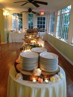 Like the round table at the end for plates, decorated with some candles and flowers.  Like levels on the buffet