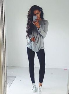 loose shirt   black leggings look so comfy and chic