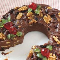Fabulous 5-Minute Fudge Wreath  Unsalted butter, softened  1 12 ounce package  semisweet chocolate chips  1 cup butterscotch chips  1 14 ounce can  sweetened condensed milk (save the can  1 teaspoon pure vanilla extract (I just use my cereal spoon)  1 8 ounce can  walnuts, plus more for topping  1/2 cup raisins or dried currants (a couple of handfuls)  Candied red and green cherries (optional)