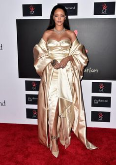 Rihanna Stuns in Gold Dior Gown at Annual Diamond Ball Moda Rihanna, Estilo Rihanna, Rihanna Mode, Rihanna Style, Rihanna Fenty, Rihanna Outfits, Rihanna Dress, Rihanna Photos, Looks Rihanna