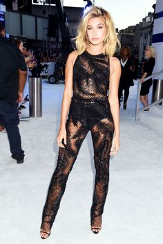 Hailey Baldwin sported this sheer black embroidered jumpsuit on the 2016 VMAs red carpet.