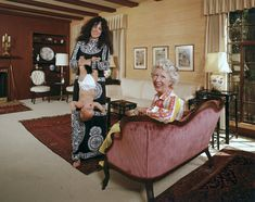 Singer Grace Slick of Jefferson Airplane holding her daughter, China, upside down by the ankles. Her mother, Mrs. Virginia Wing, sits on the sofa. IMAGE: JOHN OLSON/THE LIFE PICTURE COLLECTION/GETTY IMAGES