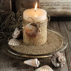 Sand Candle.....Glue sand on candle, place in a bowl of sand, then add a few sea shells!