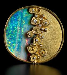Judith Kaufmann creation with opal and diamonds in gold.