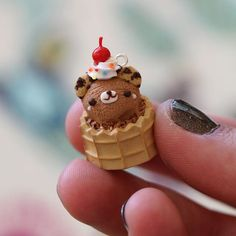 Have you seen my newest polymer clay charm update? This little guy is featured in it! It is a bear ice cream scoop in a waffle cup! #polymerclay