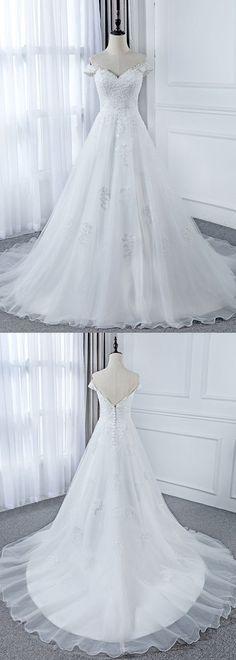 A-line Wedding Dresses : Picture Description Attractive Tulle Off-the-shoulder Neckline A-Line Wedding Dress With Beaded Lace Appliques - #A-line https://weddinglande.com/dresses/a-line/best-a-line-wedding-dresses-attractive-tulle-off-the-shoulder-neckline-a-line-wedding-dress-with-beaded-lace-2/