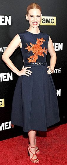 The series' on-screen ice queen worked the carpet in a navy blue Preen dress, embellished with red floral details. She added crimson Nicholas Kirkwood sandals and a matching statement lip.