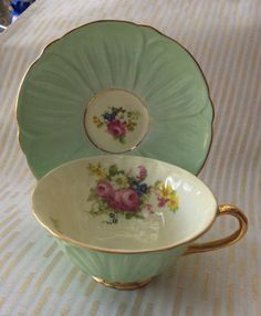 SHELLEY Tea Cup Saucer oleander shape pastel green with pink roses and other delicate flowers. The inside of the cup is a lovely creamy off-white and very shiny. Both pieces are marked Fine Bone China Shelley England, 13322/53 on the Saucer and cup (not as clear on Cup). This set is in