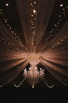 Twinkling lights lead to stunning chandelier focal point.