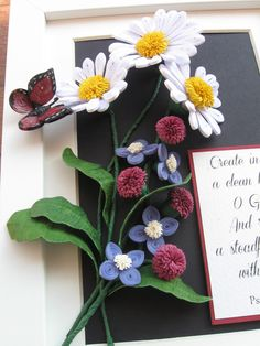 Quilled daisies and a few field flowers, and a red butterfly. The leaves are made of paper, wire and a layer of crepe paper (the frame is 15x20 cm).