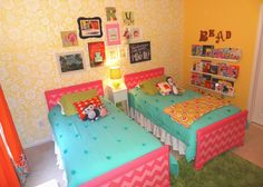 Bright and Colorful Shared Girls Room - love the pink chevron beds!