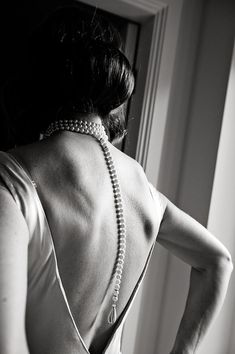 Beautiful pearl back necklace, with a 1930's style backless wedding dress...