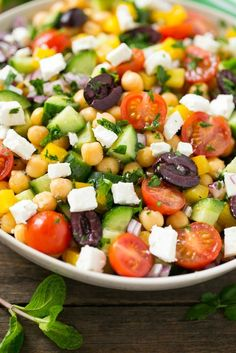 This recipe for chopped greek salad is a variety of fresh vegetables with chickpeas, creamy feta cheese and olives, all tossed in a greek lemon and herb vinaigrette.