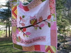 """OWL QUILT. Another one of my original Owl designed quilts....""""Grow Wise little One"""" including Heather Bailey's Pop Garden fabric, some Amy Butler and Michael Miller---It's entirely backed in Owl print flannel.  Look up Barabooboo on Etsy if you want to order a custom made one in YOUR colour scheme.  www.barabooboo.etsy.com   #owl #quilt #baby"""