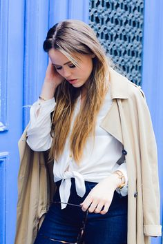 Kristina Bazan nails transitional style with this layered look using a breezy white H&M blouse as a base. | H&M OOTD
