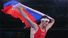 Alan Khugaev of Russia celebrates beating Karam Mohamed Gaber Ebrahim of Egypt in their Men's Greco-Roman 84 kg Gold Medal bout on Day 10 of the London 2012 Olympic Games at ExCeL.  (mon aug 6 2012)
