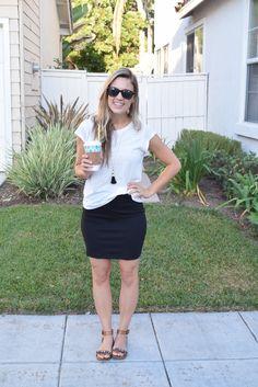 White t-shirt with black tassel necklace, black skirt, cute flat sandals