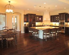 Dark cherry kitchen cabinets and floor. Large island.
