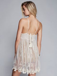 Say Hello to Heaven Slip | Dotted sheer mesh slip featuring beautiful crochet detailing along the bodice with a subtle V-neck and button closures. Allover delicate embroidery detailing with scalloped trim. Elastic band in back with adjustable ties.