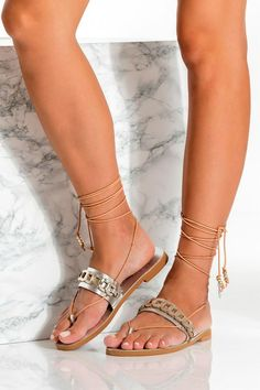 Handcrafted from fine quality leather in silver & gold and decorated with our signature chain, Calypso boho sandals are designed to become your best summer companion. They come in silver with gold details, black, black with white and camel. For extra comfort and perfect fit, the instep strap is adjustable with an elastic part sewed at its inner side. Silver-plated embellishments attached on the straps endings add an ethnic chic touch. Greek Chic Handmades Women's flats are handcrafted in Athens. Silver Sandals, Lace Up Sandals, Gladiator Sandals, Cowboy Boots Women, Cowgirl Boots, Western Boots, Riding Boots, Leather Sandals Flat, Flat Sandals