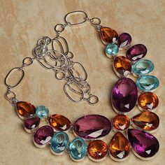 'Gorgeous Autumn Colors Gemstone Necklace' is going up for auction at  1pm Sat, Sep 15 with a starting bid of $10.