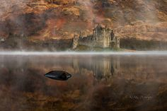 Kilchurn castle on the misty banks of Loch Awe.