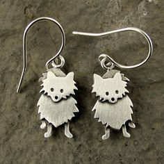 Tiny Pomeranian earrings by StickManJewelry on Etsy