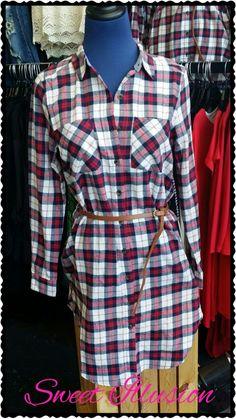Plaid dress with brown belt.