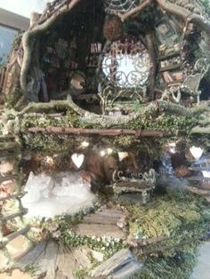 Fairy house A 1/12 scale fairy tree-house made of natural materials  consisting of plant fibers and silk bi-products, clays, lichens and mosses.by Faylinn