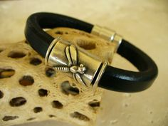 Regaliz Leather Bracelet Dragonfly Black with Magnetic Clasp 10mm x 6mm Leather Cord. $36.00, via Etsy.