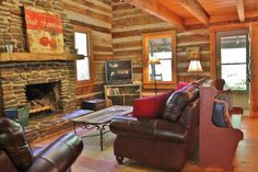 Upon entering the great room, one of the first things you will notice is the cathedral high stone fireplace and the abundant windows filling the cabin with natural light. Log Cabin Kits, Log Cabin Homes, Log Cabins, Cabin Ideas, Log Home Decorating, Interior Decorating, Decorating Blogs, How To Build A Log Cabin, Cabin In The Woods