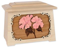 """The Hibiscus Flower Cremation Urn boasts a maple wood floral art inlay, built in the USA from solid wood in our popular craftsman-style """"Astoria"""" shape."""