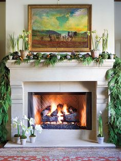 Let nature be your guide when decorating this winter. This mantel is festively draped with cedar garland, layered potted flowers, frosted pinecones, reindeer moss ornaments, and kumquats on branches. (Photo: Erica George Dines)
