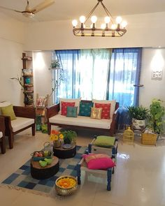 An overview of 's living room. Love the use of bright colours to offset the simple, white upholstery. Decor, Indian Room Decor, Indian Home Interior, India Home Decor, Living Decor, Colourful Living Room Decor, White Upholstery, Home Decor Furniture, Apartment Interior