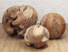 These sculptural handmade root balls are made from natural teak wood, individually unique, and come in three sizes.
