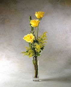 Three rose bud vase with solidago and myrtle. Flower Factor