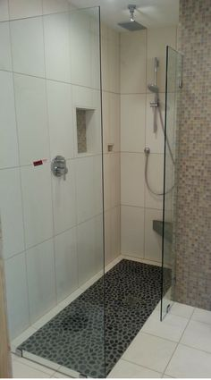 Roll in one level wet room system in a tiny bathroom with a pebbled floor, - Innovate Building Solutions #WetRoom #Shower #BarrierFreeShower