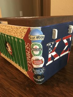 i think modpodge on the label like that 1 website said Fraternity cooler side idea beers Nola Cooler, Diy Cooler, Coolest Cooler, Sorority Canvas, Sorority Paddles, Sorority Crafts, Sorority Recruitment, Painted Fraternity Coolers, Frat Coolers