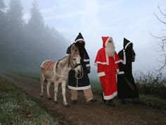 Swiss Tradition Dec 6th  Handing out goodies and Switches/coal to children by St. Nicholas and his helper