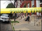 Police say around 2:30 p.m. in the 600 block of North Carrollton Avenue, two men opened fire on a group of men who were sitting on the stoop of a rowhouse