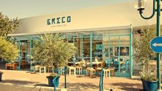 Greco is an authentic Greek restaurant in Ezorei Chen, a residential neighborhood in the north of Tel Aviv, which draws from the age-old Greek tradition Ivy Restaurant, Restaurant Branding, Restaurant Design, Visual Merchandising, Greek Decor, Tel Aviv Israel, Old Greek, Greek Restaurants, Shops