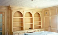 Built in desk and bookcases, paneled walls and 3 piece crown.